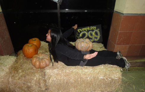Yoga anywhere, anytime.  Even on a pumpkin patch :)